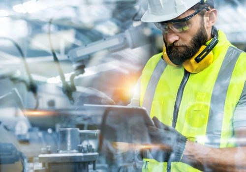 Manager or Industrial engineer working and control robotic with industry factory and network connection automation robot arm by tablet. AI, Artificial intelligence.